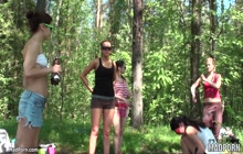 Several topless girls camping