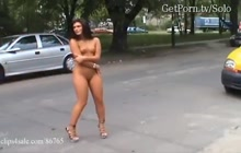 Beauty dark haired walking naked on a street with Justyna Steczkowska