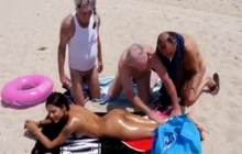 Beach babe and older guys