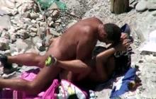 Mature couple fucks on the beach