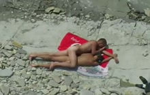 Young couple fucks on the beach