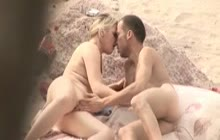 Blonde babe blows cock at the beach