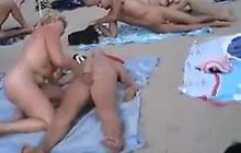 Horny couples fucking at nudist beach
